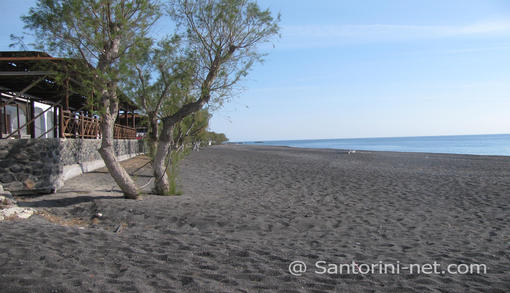 One of the most popular beach in Santorini, Kamari and its black sand