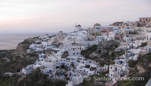 Panoramic view of Oia settlement during twilight right after sunset.