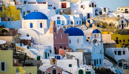 Oia village, you can see the cave houses as well as the tholos of St. Spyridon
