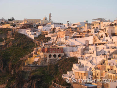 View of Fira Santorini, while the sun is going down.